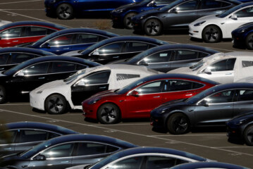 Tesla Profit Declines, but Musk Says Cash Position Is Strong