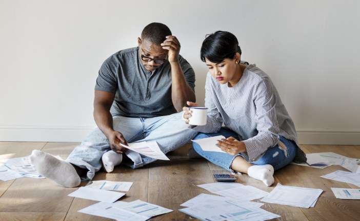 Should You Buy A House If You're In Debt?