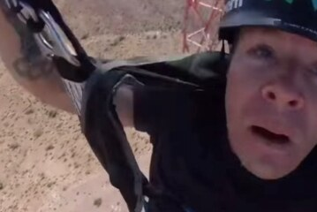 BASE Jumper Gets Blown Off Course, Almost Ends Up In A Painful Cartoon Landing